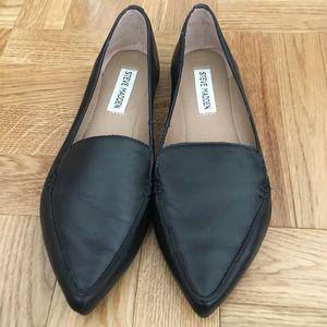 Black leather flats